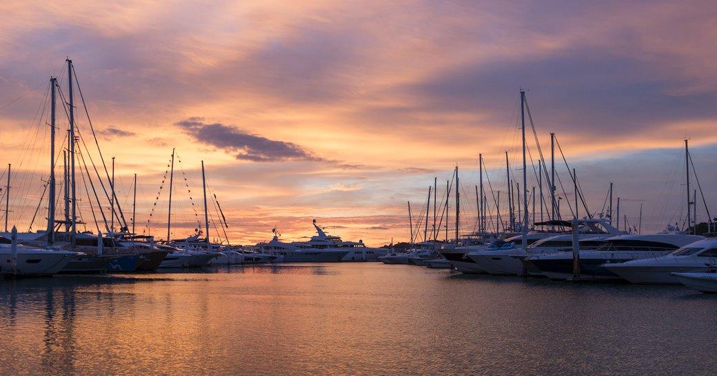 sun sets over the Thailand Yacht Show 2018 in Ao Po Grand Marina, Phuket