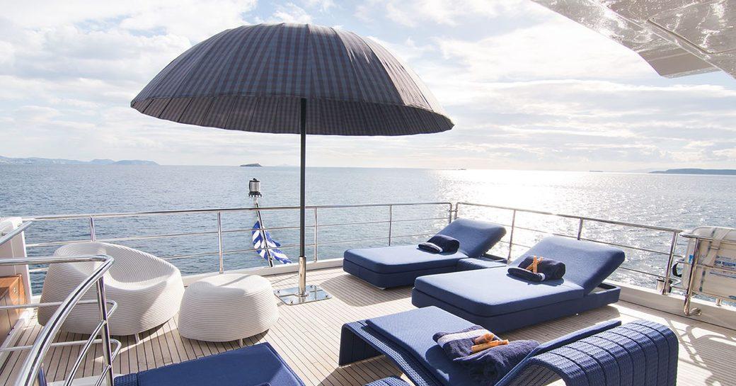 Sunbeds on aft deck of motor yacht MEMORIES TOO
