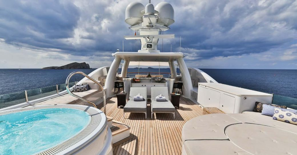 spa pool and sunning options on the sundeck of luxury yacht DENIKI