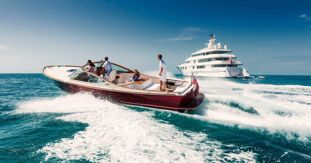 charter guests make their way to superyacht Lady E on a tender