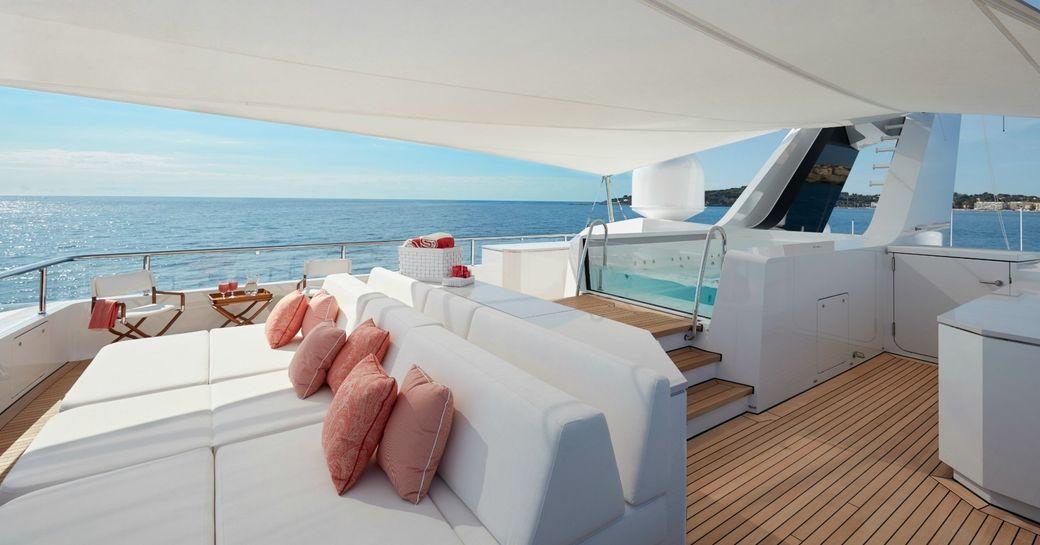 Jacuzzi and sunpads on sundeck of superyacht JOY