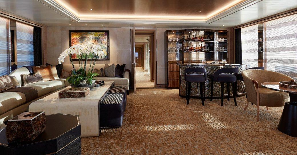 comfortable seating and Irish whiskey bar in the main salon aboard superyacht JOY