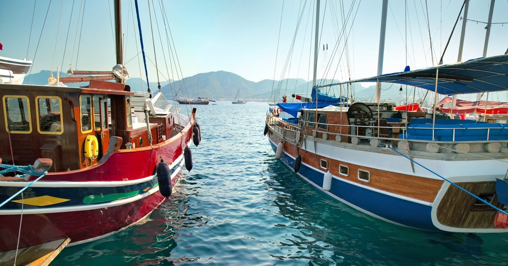 luxury gulets lined up in Turkish harbour