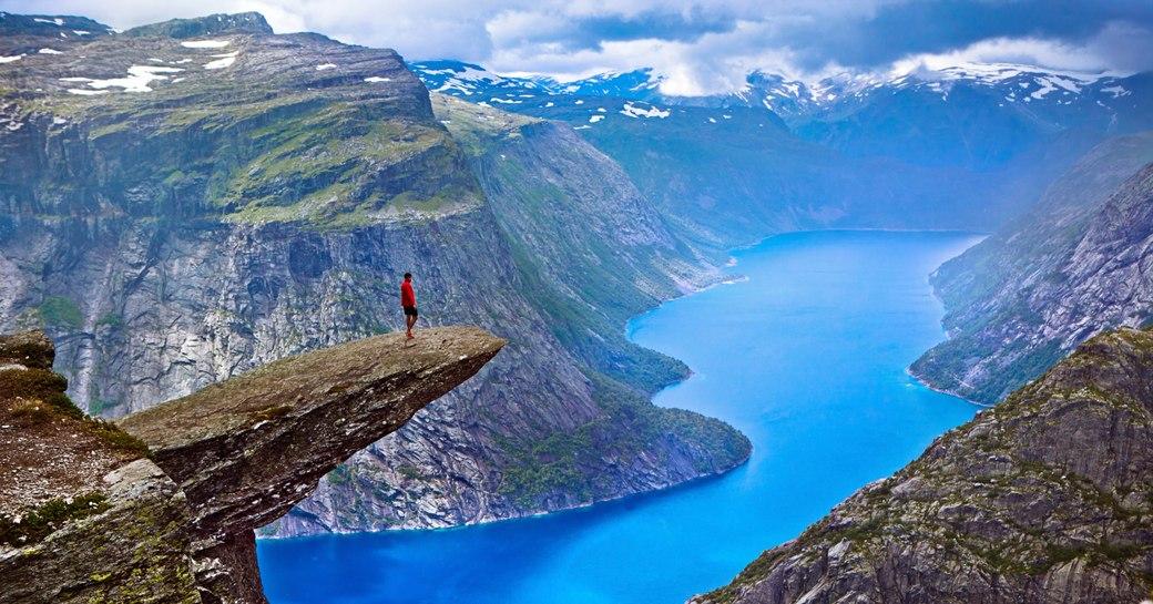 hiker on Trolltunga rock, Norway