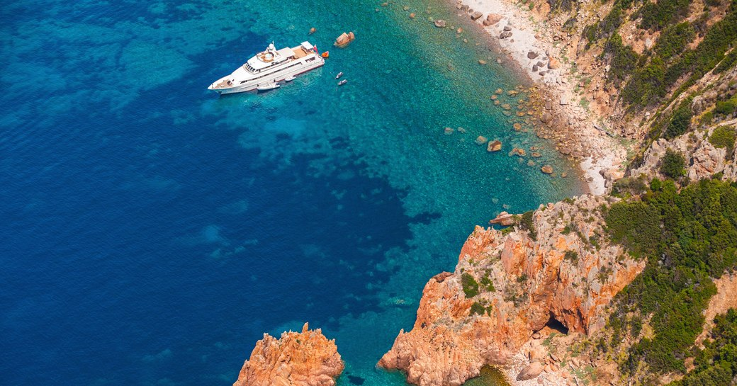 luxury charter yacht practising social distancing in sheltered cove