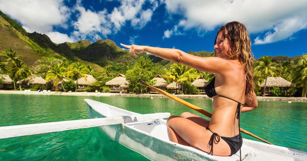 charter guest explores the beautiful Fijian coast by canoe