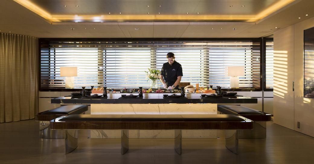 chef preparing food at the sushi bar on board luxury yacht NAUTILUS