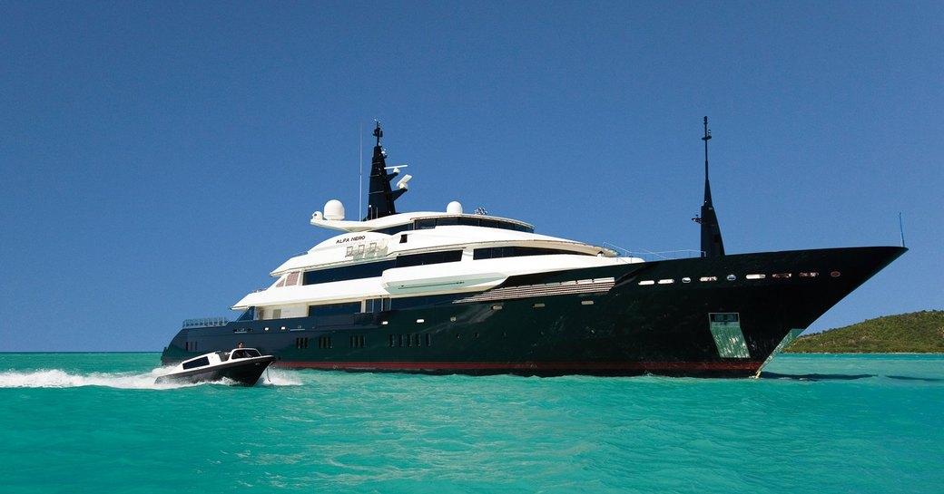 superyacht Alfa Nero underway alongside matching tender of a luxury yacht charter