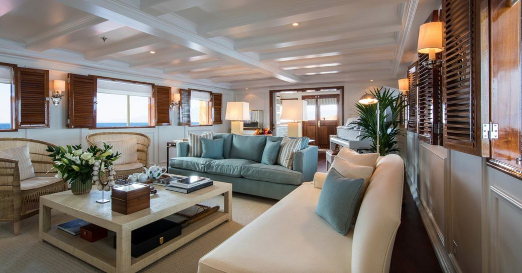 salon with two sofas and armchairs on board classic yacht Haida 1929