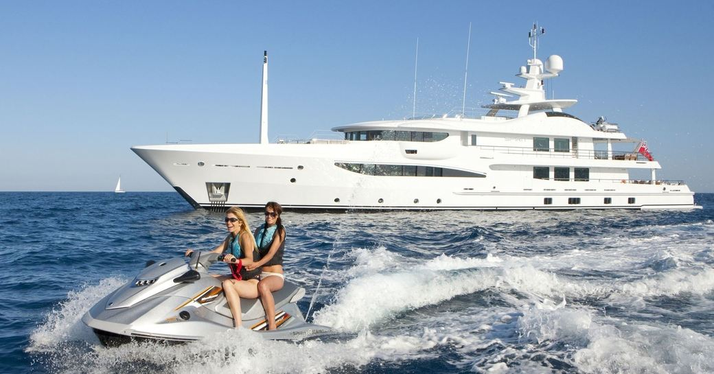 charter guests aboard superyacht SPIRIT take to the jet ski