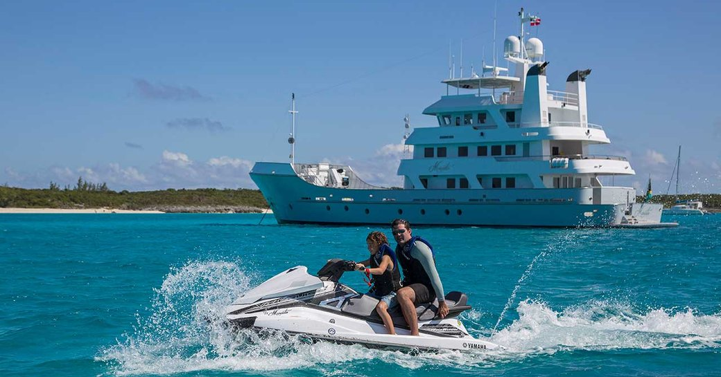 Couple of water toy in front of MARCATO explorer yacht