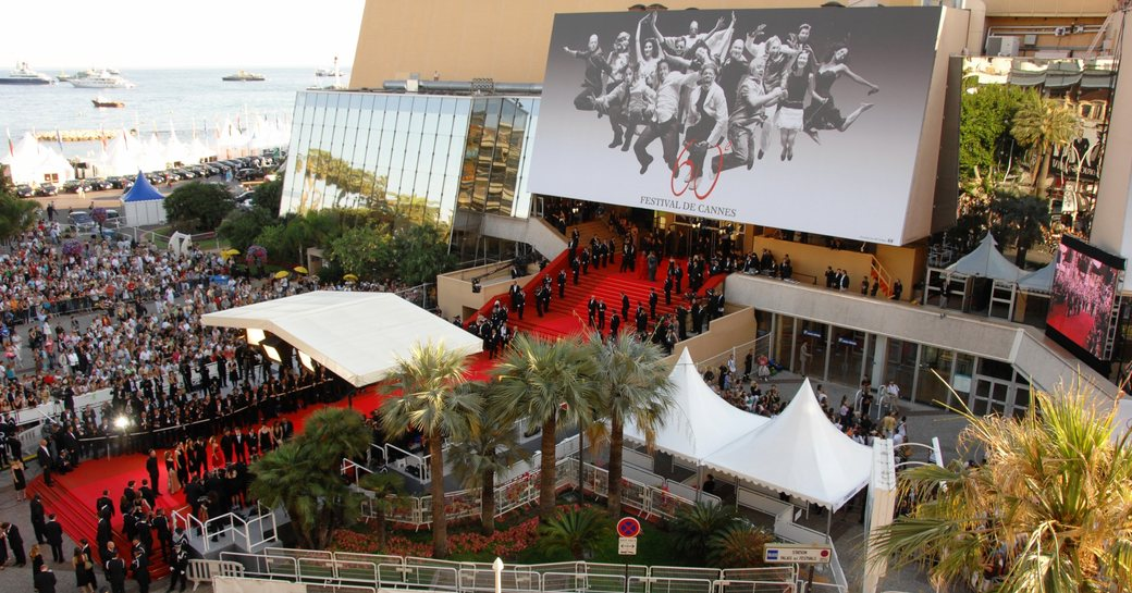 crowds gather around the red carpet at the Palais des Festivals for a premier at the Cannes Film Festival