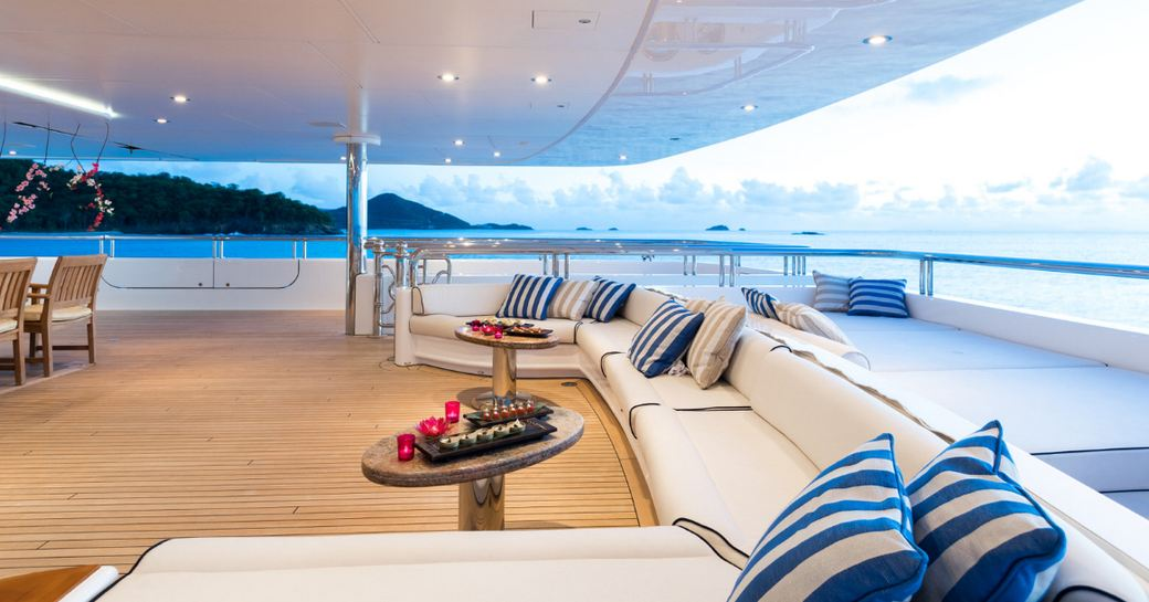 long, built-in sofa on the aft deck of superyacht TITANIA