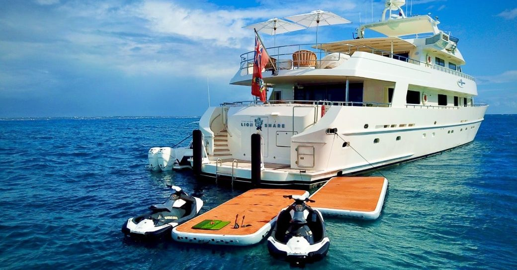 Aft of superyacht LIONSHARE with two tenders and swimming platform in view