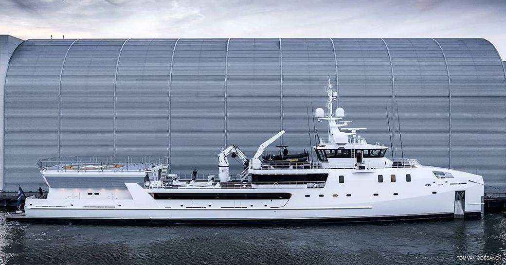 Game Changer yacht after extension in front of refit shed