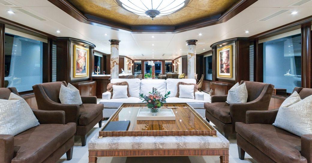 lavish main salon with mahogany wall panels in the main salon of charter yacht STARSHIP