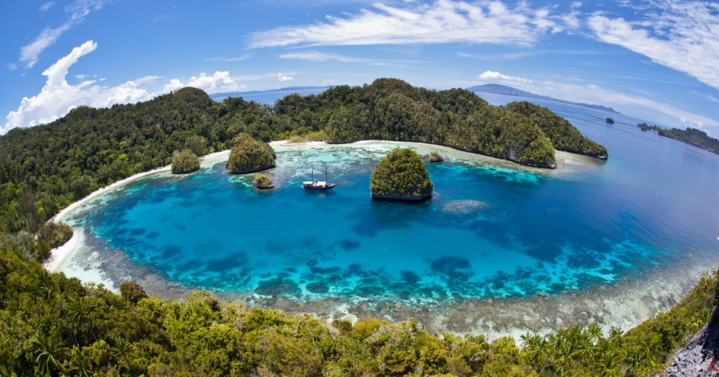 Coral islands and pristine blue waters of Raja Ampat in Indonesia