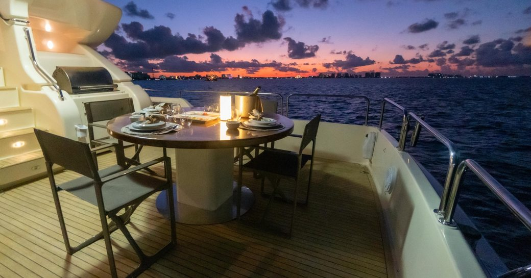 Laid table in open air on deck of charter yacht NOMADA