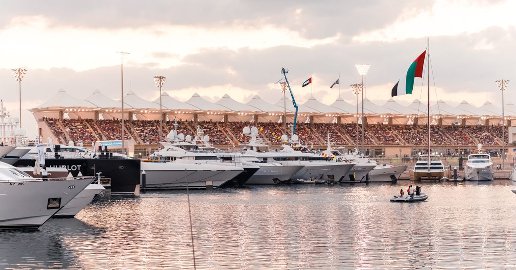 superyachts berth in Yas Marina with grandstand in the background for the Abu Dhabi Grand Prix