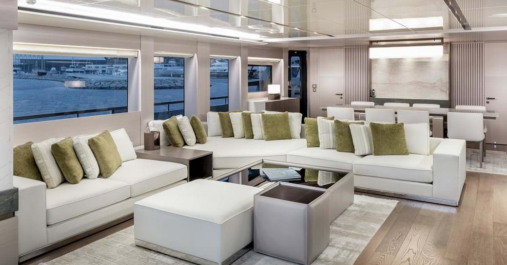 Main saloon on explorer yacht 'Seven Diamonds' with lightly colored sofas and tables