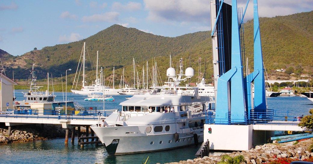A chartered private luxury yacht leaving Isle de Sol through the Simpson Bay Drawbridge