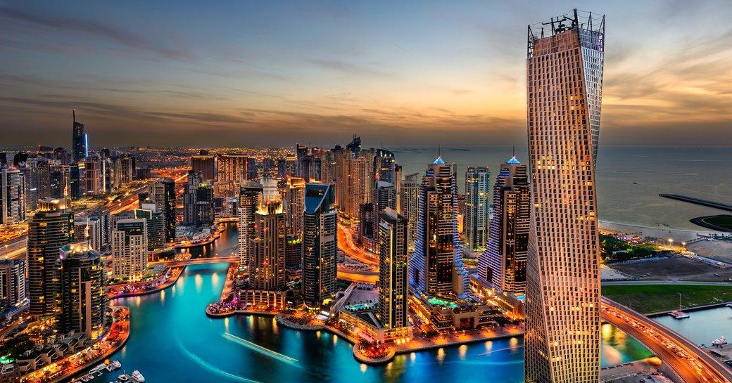 Dubai marina and cityscape as the sunsets