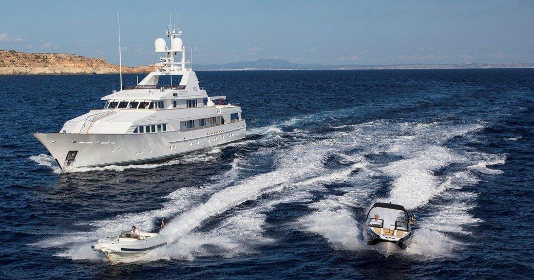 motor yacht MQ2 gets underway alongside tenders