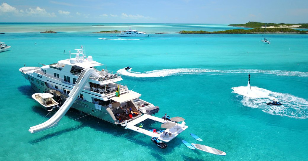 charter superyacht loon in the blue waters of the exumas practising social distancing