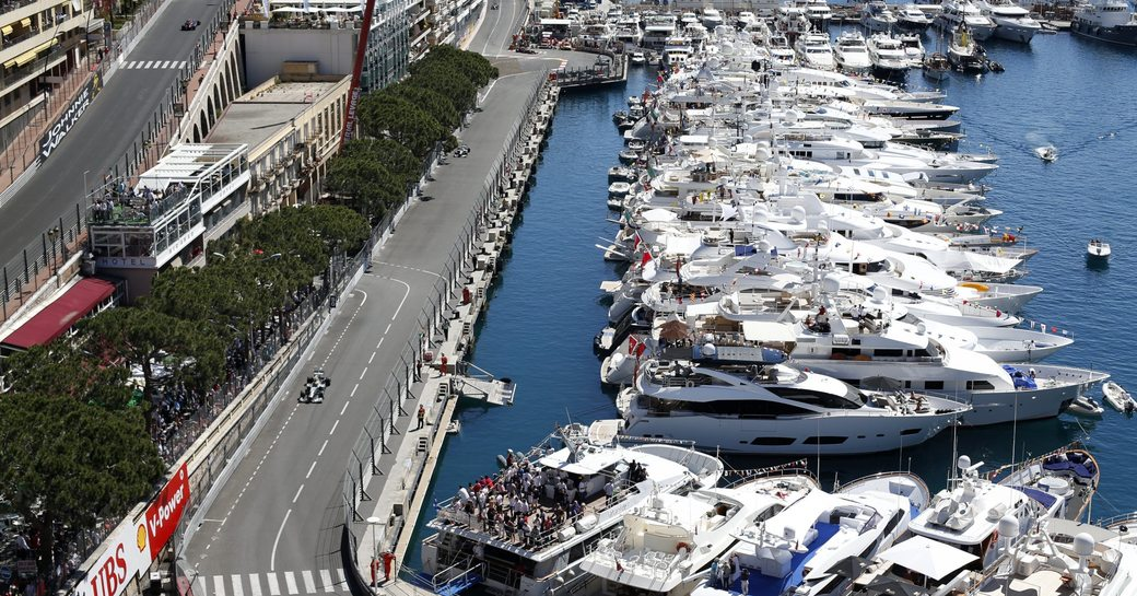 Monaco Grand Prix track curves round Port Hercules which is lined with superyachts