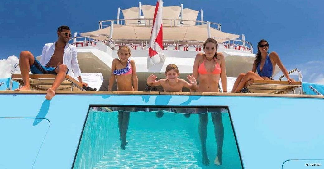 Guests enjoying the pool onboard MY Axioma