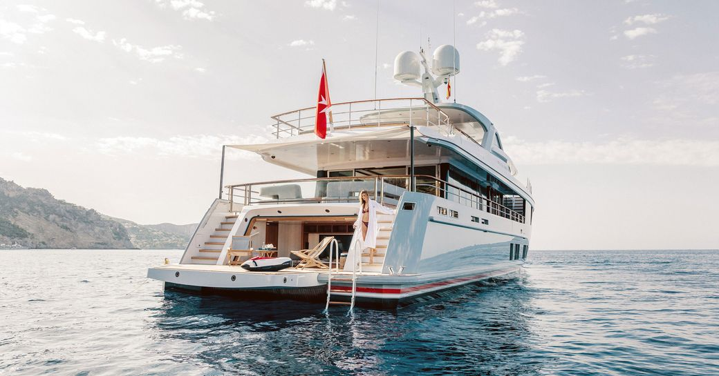charter guest in the beach club with its drop-down swim platform on board superyacht CALYPSO