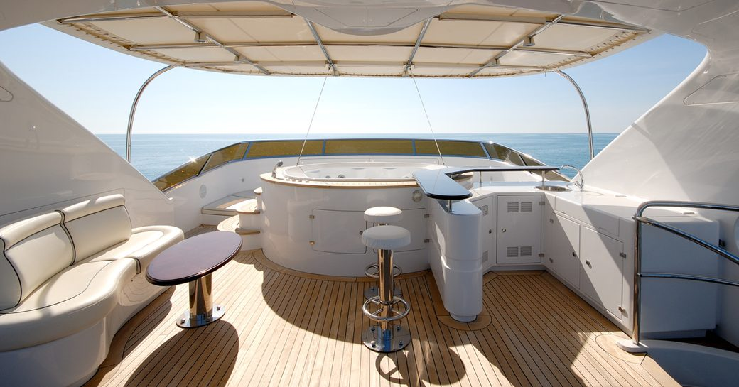 Jacuzzi, bar and seating area on the sundeck of superyacht 'Elena Nueve'