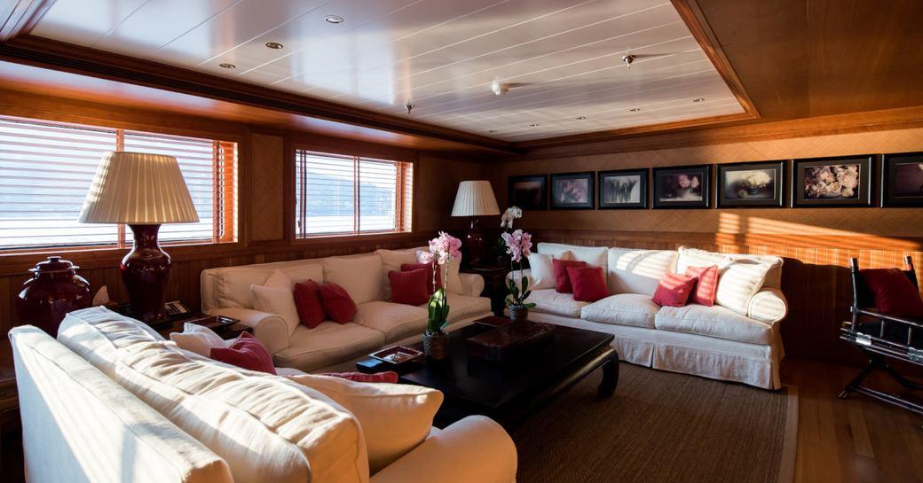Elegant interior with sofas and tables on superyacht Bleu De Nimes