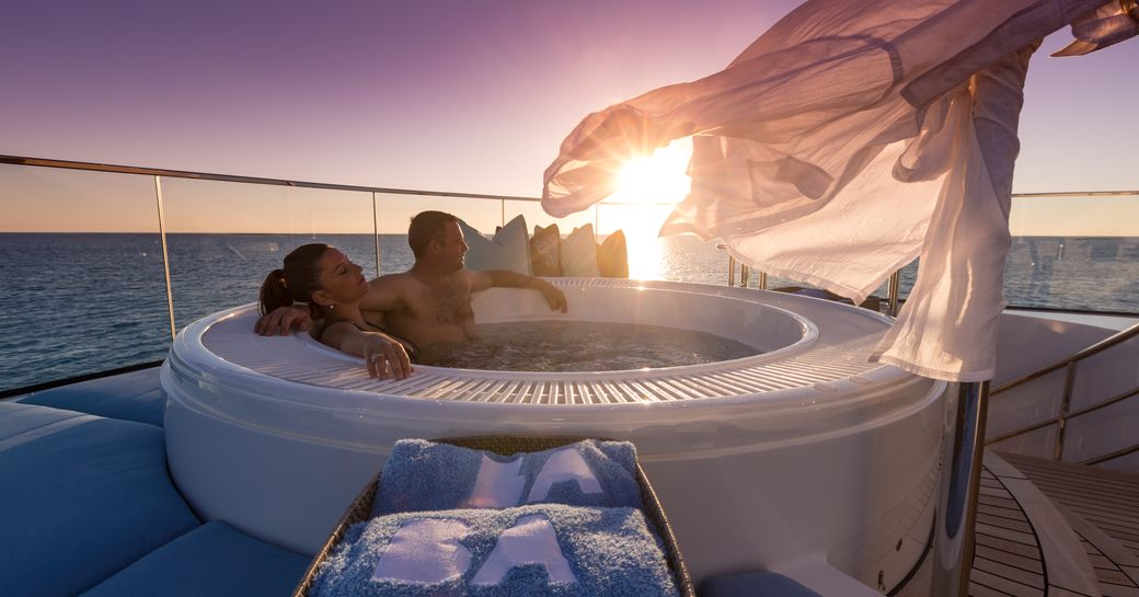 Couple in Jacuzzi on Superyacht BACA