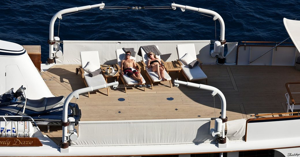 guests relax on the vast sundeck aboard classic yacht 'Heavenly Daze'