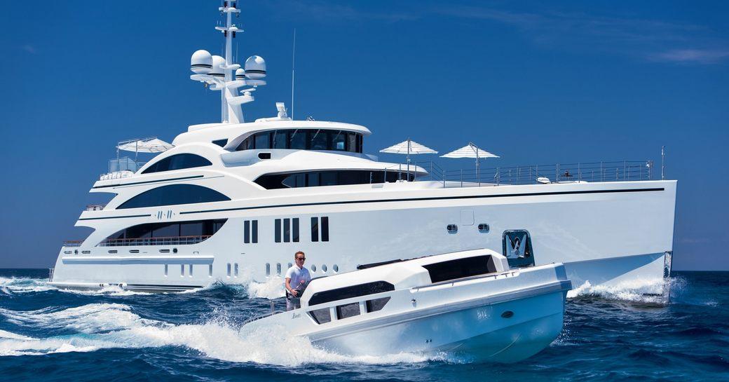 superyacht 11/11 cruises alongside custom limo tender