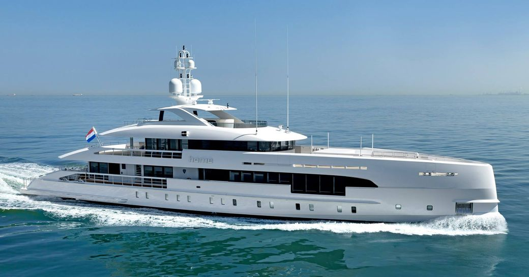 Charter yacht HOME underway, surrounded by sea