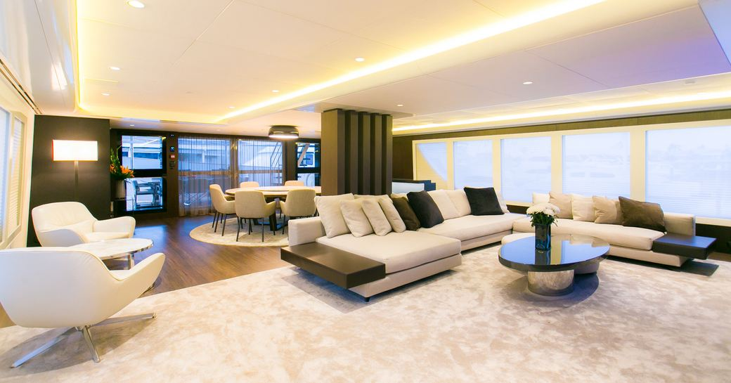 stylish and modern main salon on board motor yacht SAHANA with sumptuous lounge and dining table