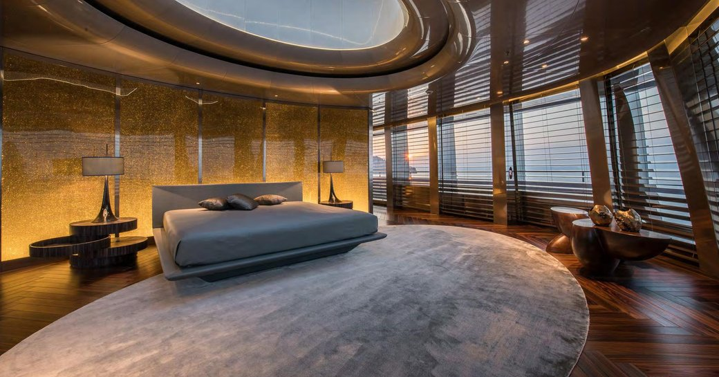 Large bedroom on superyacht SAVANNAH, with lots of open space and windows all around