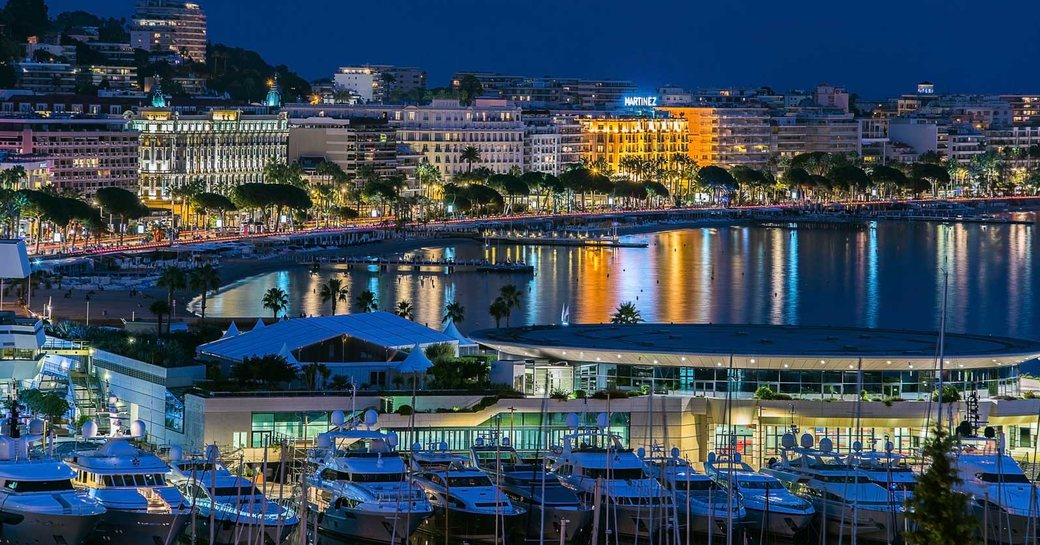 superyachts lined up in the Old Port of Cannes