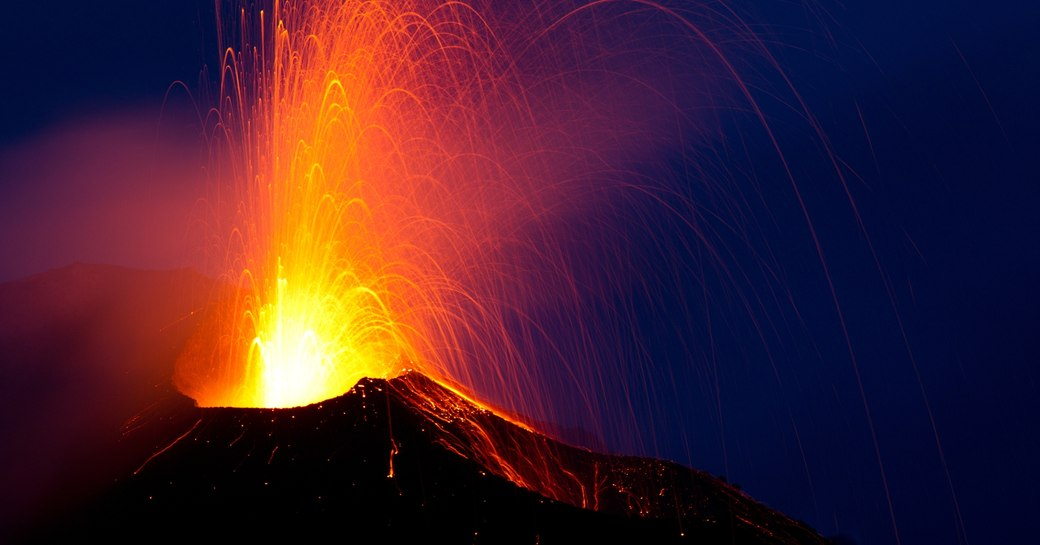 sparks fly out of Stromboli volcano at night on Stromboli Island