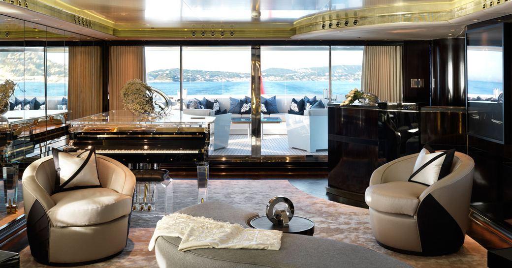 Art deco-themed main salon with bar and piano on board motor yacht SEALYON