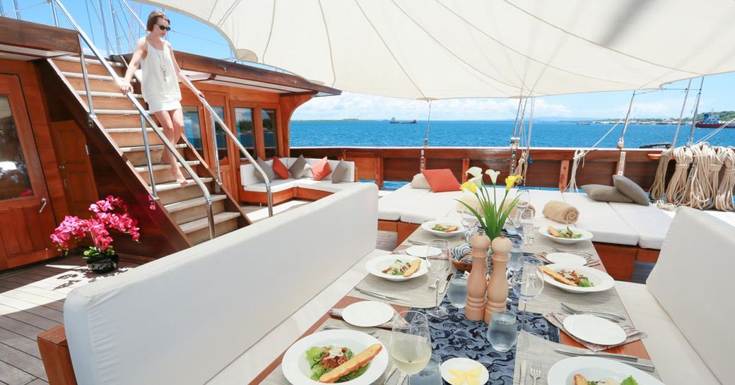 dinner is served on the foredeck alfresco dining area aboard charter yacht LAMIMA