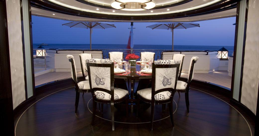 circular dinning area with full-length revolving glass doors on board superyacht Alfa Nero