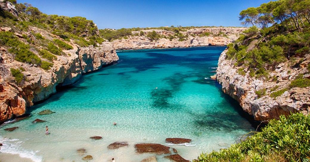 pretty bay in ibiza with clear blue sea