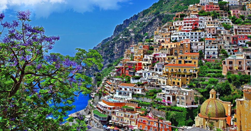 colourful buildings tumble down the hillside to the blue seas in Sorrento along the Amalfi Coast