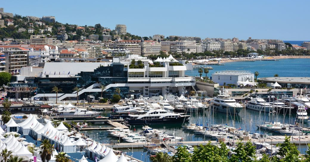 superyachts berthed in the Old Port, Cannes, with Palais des Festivals in background