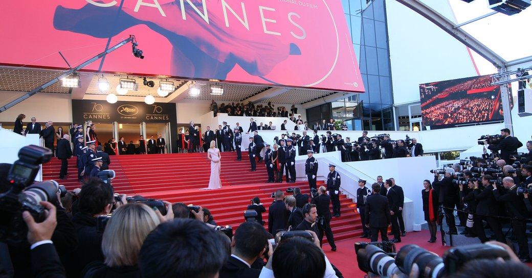 Uma Thurman on steps of Palais des Festival at the Cannes Film Festival