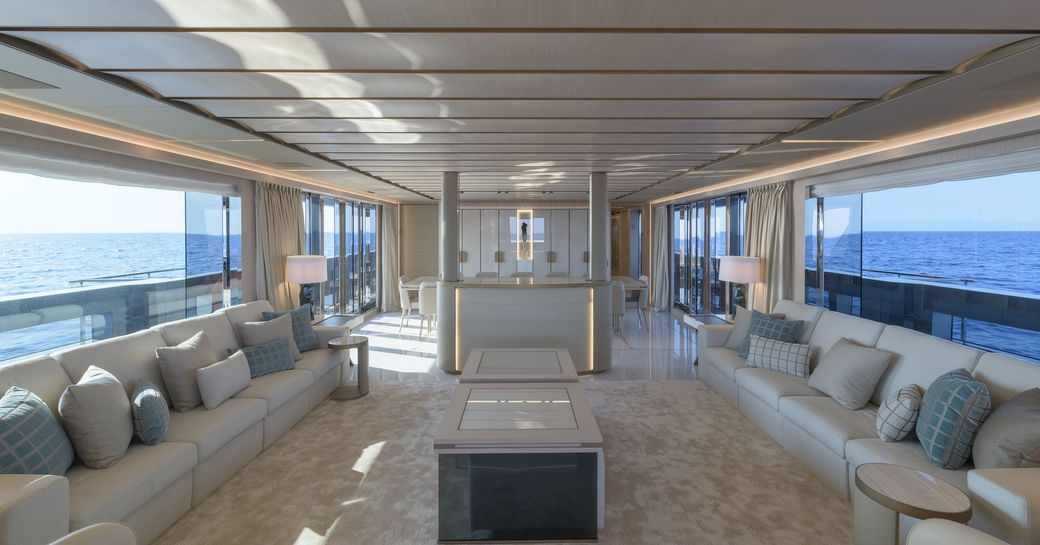 Light filled interior on superyacht EIV with sofas and table