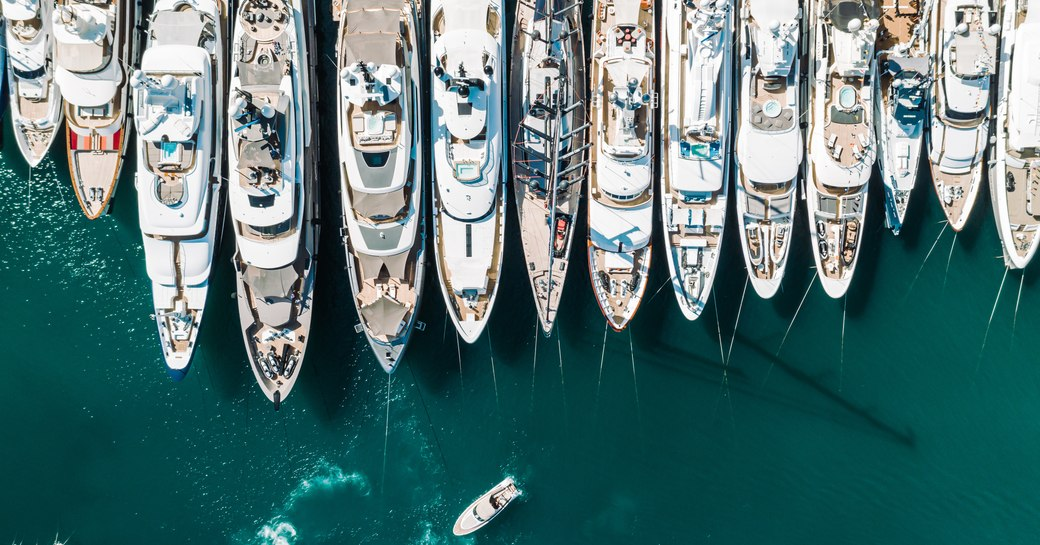 Aerial view of line of superyachts moored at Monaco Yacht Show.